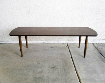 Vintage Mid Century Surfboard Coffee Table in Formica Walnut Finish. Circa 1960's.