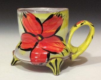 red flower mug with striped feet