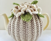 Hand-knitted Floral tea cosy - in soft neutral tones - fits medium 6 cup teapots