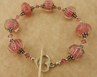 Awareness Bracelet with Pink lampwork glass beads with Swarovski crystals and a sterling silver heart toggle