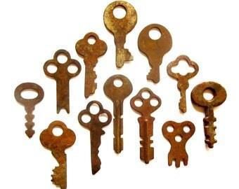 12 vintage keys Primitive and rustic keys Vintage flat keys Artist supply keys Small keys Odd flat skeleton keys Flat skelton key Rusty #32