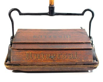 Antique Wooden Bissell Cyco-Bearing Universal Sweeper