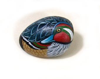 Little duck hand painted on a stone