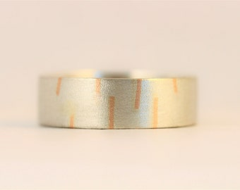 Red gold inlaid Rain ring in sterling silver and 9ct red / rose gold.