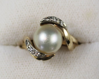 Vintage Yellow Gold Pearl and Diamond Bypass Ring