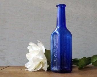 Antique Cobalt Blue Glass Apothecary Medicine Bottle - Laxol 3 sided blue glass bottle A J White dangerous drug