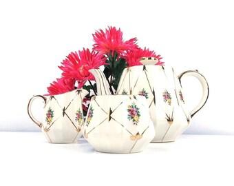 vintage 30s sadler tea set china teapot creamer sugar bowl serving entertaining white flowers floral pattern metallic gold trim 3008 signed