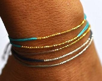 SALE items ship March 1st Gold beads on Turquoise silk friendship bracelet. Silk bracelet. Modern bracelet.