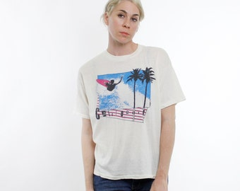 Vintage 80's California design shirt, surfer, palm trees, ransom lettering, wide cropped body style, off white - Large