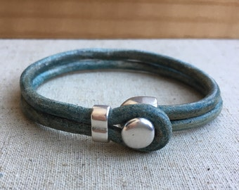 LEATHER CUFF bracelet. TEAL/tuquoise distressed leather with silver button clasp.