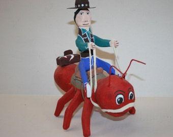 Navajo Folk Art Carving Delbert Buck Cowboy On Red Ant
