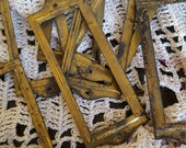 Seven Small brass colored vintage metal frames