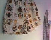Vintage 80s High Waist Badge of Honor Print Shorts