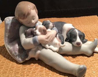 Lladro Boy with his dog and puppies