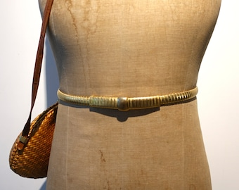Vintage 1980s Accessorcraft NYC  stretch gold tone belt