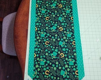 Holiday Table runner. St. Patrick's day,  Shamrocks, clover, lucky horseshoe,  leprechaun hat,  green.  Approx. 13 x 41 inches.