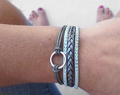 leather braided bracelet in silver and aqua with lobster clasp chain closure. infinity circle charm.