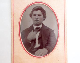 antique tintype with paper frame - young man with dimpled chin