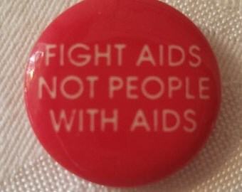 """Vintage button that reads """"Fight AIDS Not People With Aids"""""""