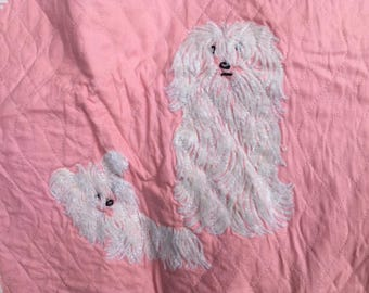pink quilted fabric with puppies