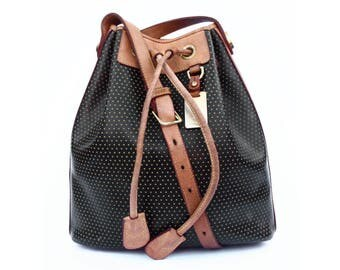 Perforated Dooney and Bourke Drawstring Leather Bucket Bag