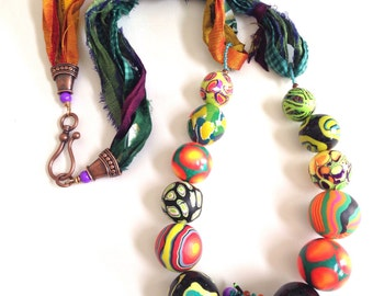 Long bright polymer and felted bead necklace with sari silk ribbon.