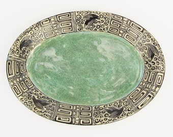 ceramics and pottery serving plate; ceramic serving plate; ceramic art; hand carved pottery