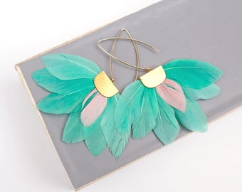 Pastel Mint Feather statement earrings by Pardes