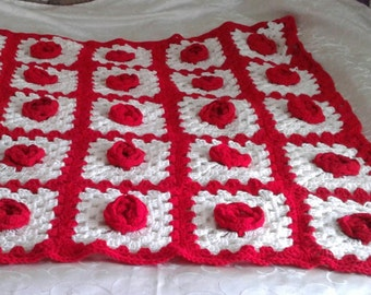 Red and white granny square rose afgan