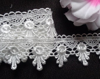 1 3/4 inch wide white ( not snow white)Embroidered Lace trim price for 1 yard