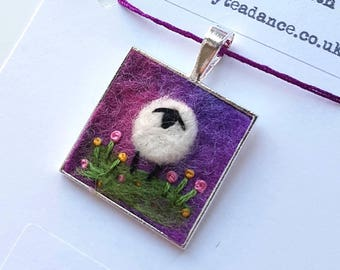 Needle felted and hand embroidered miniature collage mounted into a silver plated pendant