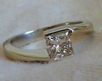 High end 14k Tension set bezel set approx. .60 carat Fine princess cut diamond solitaire. Size 5. Heavy.