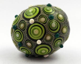 Handmade focal lampwork glass bead in green and ivory