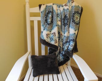 Gray, blue, and white Minky blanket and pillow set . Pretty medallion print on the front grey minky on the back.