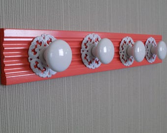 Coral coat/ towel  rack with 4 super large acrylic knobs and decorative back plate on fluted moulding 20inches long