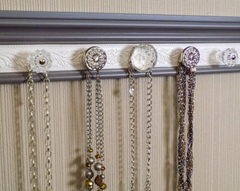 Jewelry organizer  CHOOSE 5, 7 or 9 KNOBS  Can add hooks also. This gray wall  necklace rack has shimmery white  embossed background .  gift