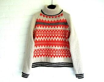 Handknitted Turtleneck Sweater Raglan Ethno-Glam Jacquard Front and Backside Black Sand Orange