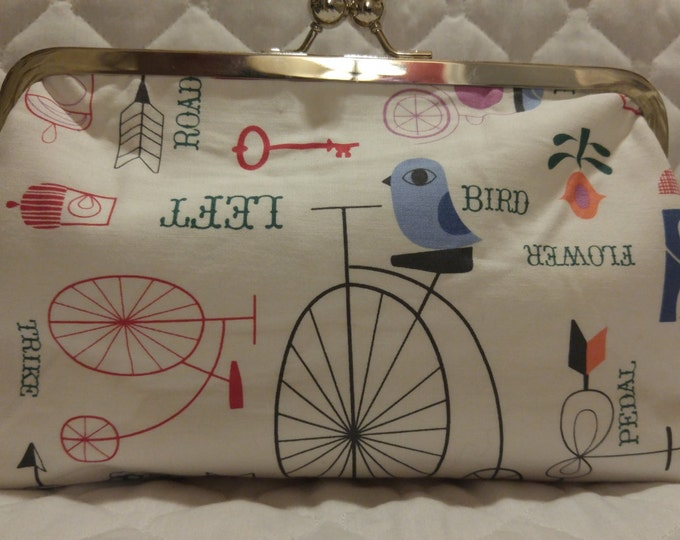 Whimsical bird and bikes clutch