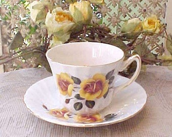Pretty Vintage English Porcelain Teacup and Saucer with Yellow Roses