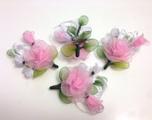 Pink roses with pins