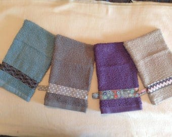 Terry cloth shower or bath mitt set of four, in purple, tan, grey and light blue with hanging loop and premium trim