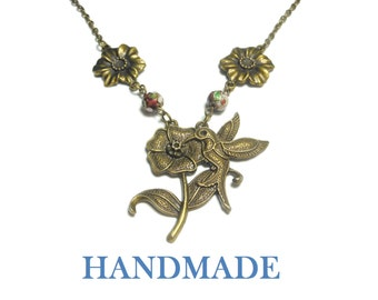 Hummingbird necklace handmade, antiqued bronze flower with hummingbird, red floral cloisonne beads and antiqued bronze flower links