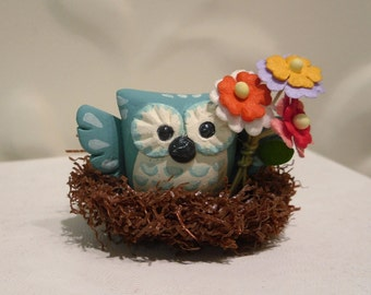 Cute Owl sitting in nest holding flowers - Fun gift for Valentine's Day