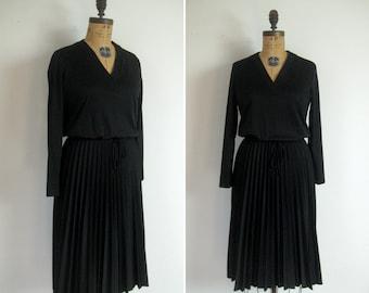 1970s minimalist black dress • 70s noir day dress • vintage chasing shadows dress