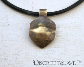 Brass curved non-binary gender fluid shield for masters. Pendant for owners, Dominant or Masters in a BDSM relationship