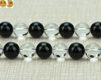 15 inch strand of natural Black Onyx and Rock Crystal Quartz smooth round beads 6-12mm