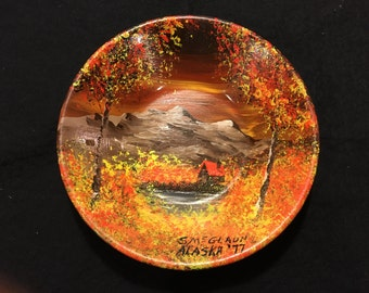 Painting on gold mining pan from Alaska.
