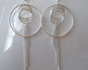 Silver Tone Hoop Earrings with Silver Tone Ring Charms and Silver Tone Chain Dangles