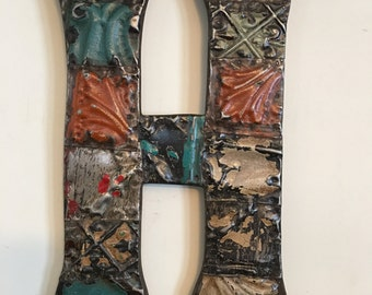 """Patchwork letter """"H"""" designed with antique tin ceiling tiles"""