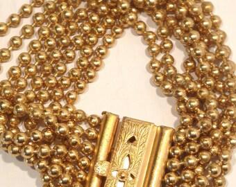 Wonder Women Wear 8 Strand Beaded Chain Bracelete with Ornate Clasp